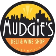 This is the restaurant logo for Mudgie's Deli