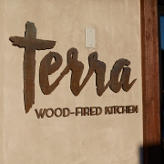 This is the restaurant logo for Terra Wood-Fired Kitchen