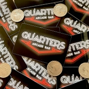 This is the restaurant logo for Quarters Arcade Bar