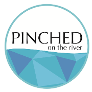 This is the restaurant logo for Pinched on the River
