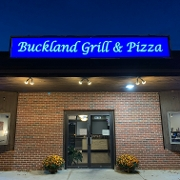 This is the restaurant logo for Buckland Grill & Pizza