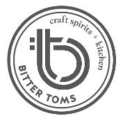 This is the restaurant logo for Bitter Tom's Distillery