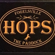 This is the restaurant logo for Hops at the Paddock