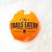 This is the restaurant logo for The Trails