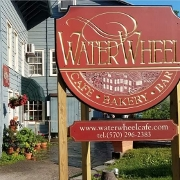This is the restaurant logo for Waterwheel Café, Bakery & Bar