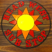 This is the restaurant logo for Head West Sub Stop