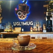 This is the restaurant logo for Ugly Mug Bean & Brew