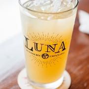 This is the restaurant logo for Luna Rotisserie & Empanadas