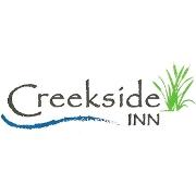 This is the restaurant logo for Creekside Inn