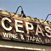 This is the restaurant logo for Cepas Wine Bar