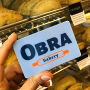 This is the restaurant logo for OBRA Bakery