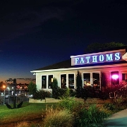 This is the restaurant logo for Fathoms Bar and Grille