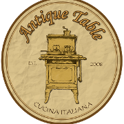 This is the restaurant logo for Antique Table Restaurant