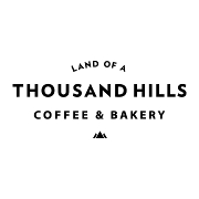 This is the restaurant logo for Land of a Thousand Hills Coffee  & Bakery