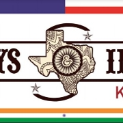 This is the restaurant logo for Cowboys & Indians Tex-In Kitchen - Houston