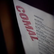 This is the restaurant logo for Comal Next Door